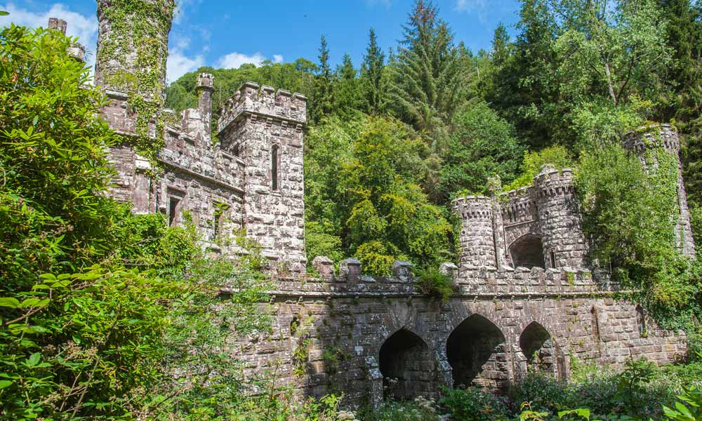 Neo gothic Ballysaggartmore Towers and bridge surrounded by woodland
